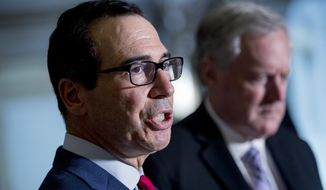 Treasury Secretary Steven Mnuchin, left, accompanied by White House Chief of Staff Mark Meadows, right, speak to reporters following a meeting with House Speaker Nancy Pelosi of Calif. and Senate Minority Leader Sen. Chuck Schumer of N.Y. as they continue to negotiate a coronavirus relief package on Capitol Hill in Washington, Friday, Aug. 7, 2020. (AP Photo/Andrew Harnik) **FILE**
