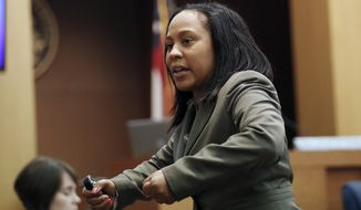 FILE - In this Wednesday, Aug. 24, 2016, file photo, Fulton County Deputy District Attorney Fani Willis makes her closing arguments during a trial in Atlanta. Fulton County District Attorney Paul Howard has run unopposed for two decades. But he came in second to his former longtime assistant Willis in the June Democratic primary and faces a tough runoff election Tuesday, Aug. 11, 2020. (AP Photo/John Bazemore, File)