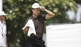 Li Haotong, of China, wipes his face while on the practice green at the World Golf Championships-FedEx St. Jude Invitational Wednesday, July 29, 2020, in Memphis, Tenn. (AP Photo/Mark Humphrey)