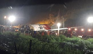 The Air India Express flight that skidded off a runway while landing at the airport in Kozhikode, Kerala state, India, Friday, Aug. 7, 2020. (AP Photo)