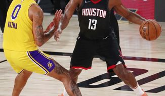 Houston Rockets guard James Harden (13) dribbles while defended by Los Angeles Lakers forward Kyle Kuzma (0) during the second half of an NBA basketball game Thursday, Aug. 6, 2020, in Lake Buena Vista, Fla. (Kim Klement/Pool Photo via AP)