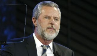 FILE - In this Nov. 28, 2018, file photo, Liberty University President Jerry Falwell Jr. speaks before a convocation at Liberty University in Lynchburg, Va. Falwell has agreed to take an indefinite leave of absence from his role as president and chancellor of Liberty University, the school announced Friday, Aug. 7, 2020. (AP Photo/Steve Helber, File)