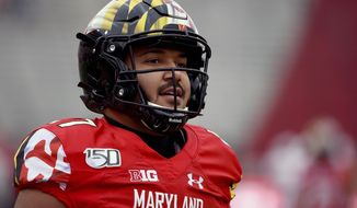 FILE - In this Saturday, Nov. 23, 2019, file photo, Maryland quarterback Josh Jackson (17) warms up prior to an NCAA college football game against Nebraska in College Park, Md. Maryland senior quarterback Josh Jackson has opted out of the upcoming football season, leaving the Terrapins with very little depth and experience at the pivotal position. Jackson is the most prominent of six Maryland players who have decided not to play in 2020 for reasons related to the COVID-19 pandemic, coach Michael Locksley said during a teleconference Friday, Aug. 7, 2020. (AP Photo/Will Newton, FIle)