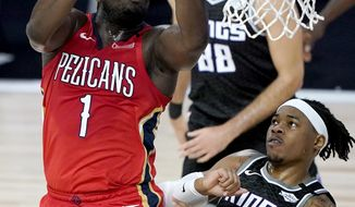 New Orleans Pelicans' Zion Williamson (1) goes up for a shot against Sacramento Kings' Richaun Holmes (22) during the first half of an NBA basketball game Thursday, Aug. 6, 2020 in Lake Buena Vista, Fla. (AP Photo/Ashley Landis, Pool)
