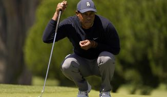 Tiger Woods lines up a putt on the third hole during the second round of the PGA Championship golf tournament at TPC Harding Park Friday, Aug. 7, 2020, in San Francisco. (AP Photo/Jeff Chiu)