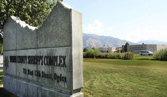 This Sept. 15, 2011 file photo shows the Weber County Sheriff Complex in Ogden, Utah. Federal inmates have sued officials who run a Utah jail, alleging a failure to adequately protect them from the coronavirus. Six inmates at Weber County Jail filed the lawsuit in U.S. District Court on Friday, asking for more inmates be released to home confinement and health measures like a mask requirement.  (Leah Hogsten/The Salt Lake Tribune via AP)