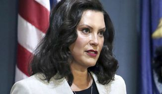 In a June 17, 2020, file photo provided by the Michigan Office of the Governor, Michigan's Democratic Gov. Gretchen Whitmer addresses the state during a speech in Lansing, Mich. Whitmer has extended Michigan's coronavirus emergency through Sept. 4, enabling her to keep in place restrictions designed to curb COVID-19. The Democratic governor on Friday, Aug. 7, 2020, pointed to an uptick in cases. Since nearly two months ago, the seven-day statewide average is up six-fold, to about 700. (Michigan Office of the Governor via AP, File)