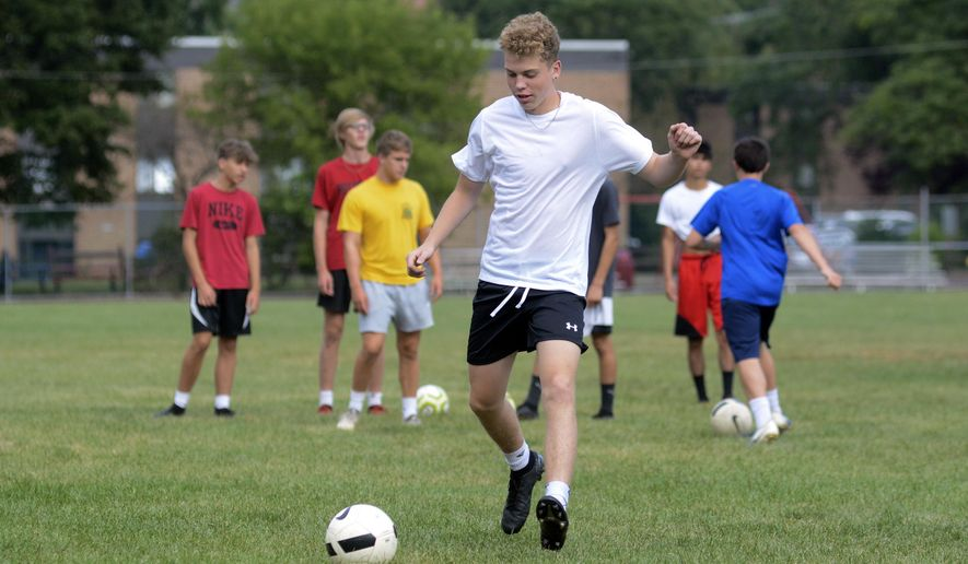 """Chase Fenstermacher kicks the ball during a wall pass drill at Pottsville's boys' soccer practice at Alumni Field in Pottsville, Pa., Thursday, Aug. 6, 2020. During a press conference Thursday, Gov. Tom Wolf recommended that no sports take place until January 1, 2021. Previously, state guidelines posted to the Governor's Office website stated that """"the decision to resume sports-related activities, including conditioning, practices and games, is the discretion of a school entity's governing body."""" Games, as also stated on the Governor's Office website, would be limited to players, coaches, officials, and staff. (Lindsey Shuey/Republican-Herald via AP)"""