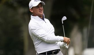Bud Cauley watches his tee shot on the third hole during the third round of the PGA Championship golf tournament at TPC Harding Park Saturday, Aug. 8, 2020, in San Francisco. (AP Photo/Jeff Chiu)