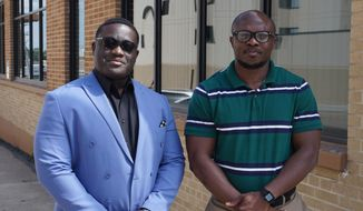 Kouadjo Bini and Iredia Ray Osadolor are members of a state New American/Foreign Born/Immigrants advisory board to the North Dakota departments of health and human services. (Jill Schramm/Minot Daily News via AP)