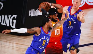 Utah Jazz's Mike Conley (10) rebounds against Denver Nuggets' Monte Morris (11) and Mason Plumlee (7) during the third quarter of an NBA basketball game Saturday, Aug. 8, 2020, in Lake Buena Vista, Fla. (Kevin C. Cox/Pool Photo via AP)
