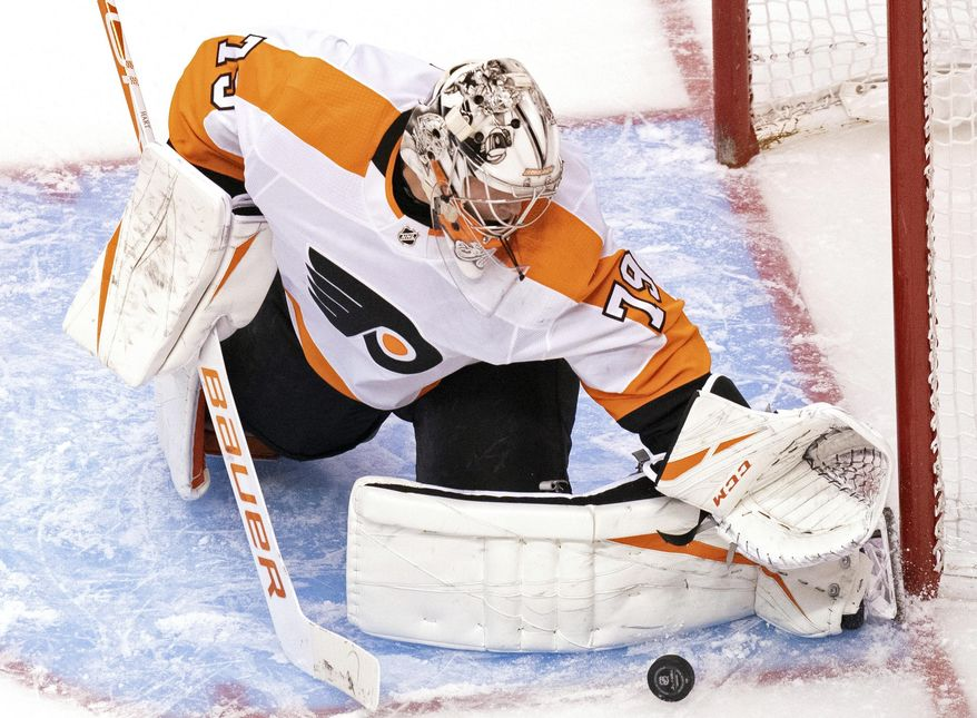 Philadelphia Flyers goaltender Carter Hart (79) makes a save against the Tampa Bay Lightning during the second period of an NHL hockey playoff game Saturday, Aug. 8, 2020, in Toronto. (Frank Gunn/The Canadian Press via AP)