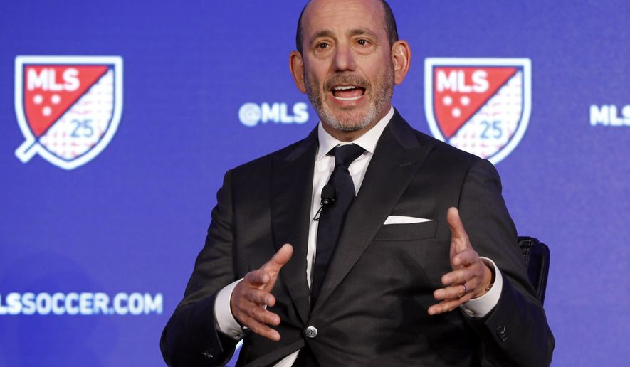 In this Feb. 26, 2020, file photo, Major League Soccer Commissioner Don Garber speaks during the Major League Soccer 25th Season kickoff event in New York. Major League Soccer said Saturday, Aug. 8, 2020, it will resume its season once the MLS is Back tournament in Florida wraps up.  The league's 26 teams will each play 18 games, with the first between FC Dallas and Nashville set for Aug. 12.(AP Photo/Richard Drew, File)  **FILE**