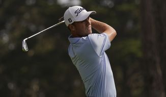 Justin Thomas watches his tee shot on the eighth hole during the second round of the PGA Championship golf tournament at TPC Harding Park Friday, Aug. 7, 2020, in San Francisco. (AP Photo/Jeff Chiu)
