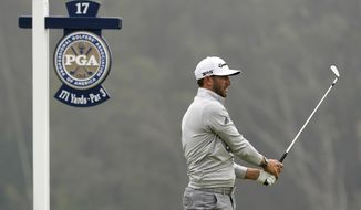 Dustin Johnson watches his tee shot on the 17th hole during the third round of the PGA Championship golf tournament at TPC Harding Park Saturday, Aug. 8, 2020, in San Francisco. (AP Photo/Charlie Riedel)