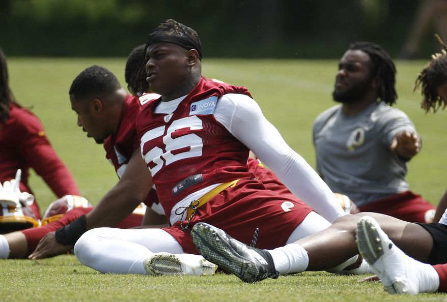 Washington linebacker Reuben Foster stretches during a practice at the team's NFL football practice facility, in a Reuben Foster Monday, May 20, 2019 file photo, in Ashburn, Va.The Washington Football Team activated linebacker Reuben Foster off the physically unable to perform list Sunday, Aug.9, 2020. The team made the move days ahead of the start of on-field training camp workouts.   (AP Photo/Patrick Semansky, File)
