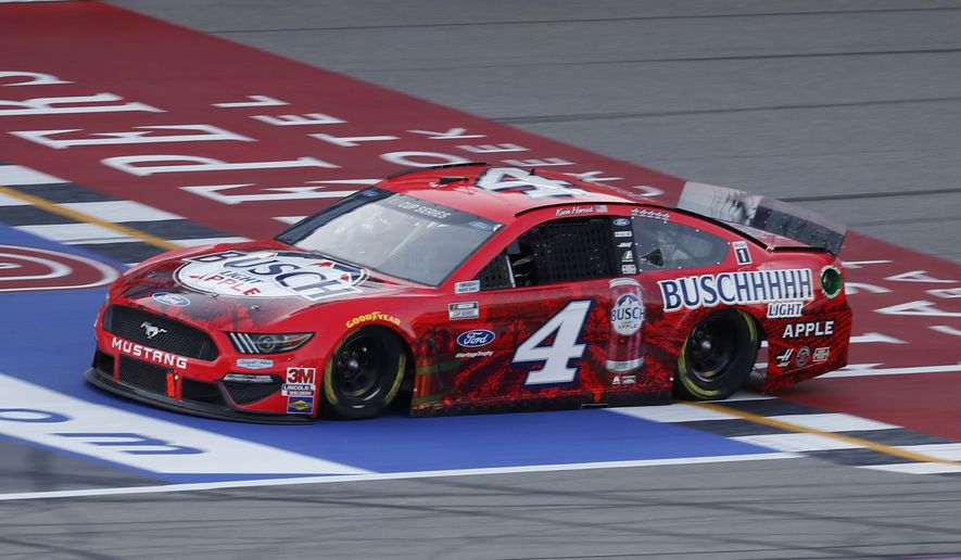 Kevin Harvick crosses the finish line to win the NASCAR Cup Series auto race at Michigan International Speedway in Brooklyn, Mich., Sunday, Aug. 9, 2020. (AP Photo/Paul Sancya)