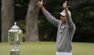 Collin Morikawa poses with the Wanamaker Trophy after winning the PGA Championship golf tournament at TPC Harding Park Sunday, Aug. 9, 2020, in San Francisco. (AP Photo/Charlie Riedel)