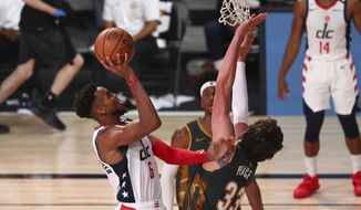 Washington Wizards forward Troy Brown Jr. (6) shoots against Oklahoma City Thunder forward Mike Muscala (33) during the first half of an NBA basketball game Sunday, Aug. 9, 2020, in Lake Buena Vista, Fla. (Kim Klement/Pool Photo via AP)