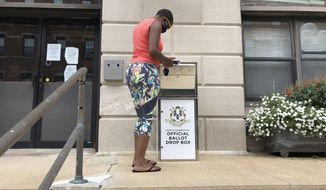 Katrina McKelvin of New London, Conn. on Aug. 6, 2020 deposits her absentee ballot for the Aug. 11 primary in a special box that has been set up outside the New London City Hall. The state of Connecticut used federal coronavirus relief funds to purchase the boxes for each city and town so voters can drop off their ballots instead of having to go personally to the polls.  (AP Photo/Susan Haigh)
