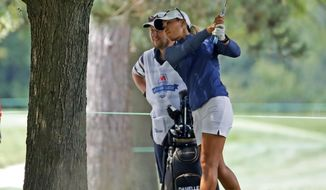 Danielle Kang hits from under a tree on the fifth fairway during the final round of the Marathon Classic LPGA golf tournament Sunday, Aug. 9, 2020, at the Highland Meadows Golf Club in Sylvania, Ohio. (AP Photo/Gene J. Puskar)