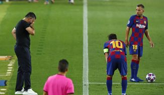 Napoli's head coach Gennaro Gattuso, left, reacts as he interacts with Barcelona's Lionel Messi during the Champions League round of 16, second leg soccer match between Barcelona and Napoli at the Camp Nou Stadium in Barcelona, Spain, Saturday, Aug. 8, 2020. (AP Photo/Joan Monfort)