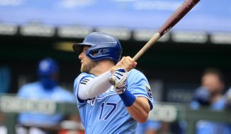 Kansas City Royals Hunter Dozier hits a two-run single during the first inning of a baseball game against the Minnesota Twins at Kauffman Stadium in Kansas City, Mo., Sunday, Aug. 9, 2020. (AP Photo/Orlin Wagner)