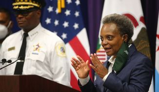 Mayor Lori Lightfoot and Chicago Police Supt. David Brown hold a news conference Monday, Aug. 10, 2020, at Chicago Police headquarters to address looting that occurred overnight in Chicago. (Anthony Vazquez/Chicago Sun-Times via AP)