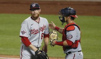 Washington Nationals catcher Yan Gomes, right, congratulates relief pitcher Sean Doolittle after the Nationals defeated the New York Mets 16-4 in a baseball game, Monday, Aug. 10, 2020, in New York. (AP Photo/Kathy Willens) ** FILE **