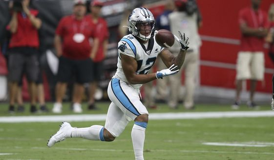 In this Sept. 22, 2019, file photo, Carolina Panthers wide receiver D.J. Moore (12) pulls in a touchdown catch against the Arizona Cardinals during the first half of an NFL football game in Glendale, Ariz. The Panthers want more out of third-year receiver D.J, Moore. Moore is coming off a solid season a year ago with 87 receptions for 1,175 receiving yards and four touchdowns, averaging 13.5 yards per catch. But the team feels he can be their No. 1 receiver.(AP Photo/Ross D. Franklin, File)  **FILE**