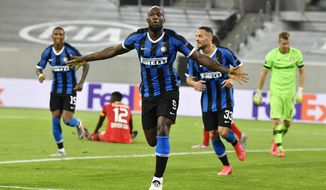 Inter Milan's Romelu Lukaku celebrates after scoring his side's second goal during the Europa League quarter finals soccer match between Inter Milan and Bayer Leverkusen at Duesseldorf Arena, in Duesseldorf, Germany, Monday, Aug. 10, 2020. (AP Photo/Martin Meissner)