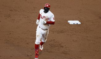 Philadelphia Phillies' Didi Gregorius rounds the bases after hitting a grand slam off Atlanta Braves pitcher Robbie Erlin during the second inning of a baseball game, Monday, Aug. 10, 2020, in Philadelphia. (AP Photo/Matt Slocum)