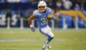 FILE - In this Dec. 22, 2019, file photo, Los Angeles Chargers running back Austin Ekeler runs against the Oakland Raiders during the second half of an NFL football game in Carson, Calif. Ekeler could be the one player who benefits the most from the Los Angeles Chargers changes on offense. (AP Photo/Kelvin Kuo, File)