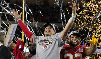 FILE - In this Feb. 2, 2020, file photo, Kansas City Chiefs' Patrick Mahomes, left, and Tyrann Mathieu celebrate after defeating the San Francisco 49ers in the NFL Super Bowl 54 football game in Miami Gardens, Fla.  Just about the only person in the world that seems to be having a good year is Patrick Mahomes. The Chiefs quarterback led his team to its first Super Bowl title in 50 years, was the game's MVP, signed a contract that could be worth a half-billion over the next decade and has grown confident enough in himself to speak out about issues that affect society as a whole.(AP Photo/David J. Phillip, File)