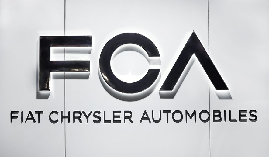 """FILE - In this Monday, Jan. 14, 2019 file photo, Fiat Chrysler Automobiles FCA logo is shown at the North American International Auto Show in Detroit. Fiat Chrysler Automobiles is denying allegations by General Motors that FCA used foreign bank accounts to bribe union officials so they would stick GM with higher labor costs. In court papers filed Monday,  Aug. 10, 2020 the Italian-American automaker said GM was using court records to make """"defamatory and baseless"""" claims.   (AP Photo/Paul Sancya, file)"""