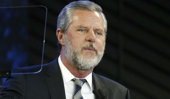In this Nov. 28, 2018, file photo, Liberty University President Jerry Falwell Jr. speaks before a convocation at the university in Lynchburg, Va. Liberty's board said Monday, Aug. 10, 2020, that it had chosen Jerry Prevo as interim leader, days after Falwell began a leave of absence after one of his posts on social media created an uproar. (AP Photo/Steve Helber, File)