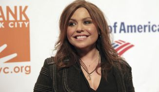 FILE - In this April 9, 2014 file photo, Rachel Ray attends the Food Bank of NYC Can Do Awards Benefit Gala on in New York.  Authorities say a massive fire engulfed Ray's New York home. The Warren County sheriff said there were no injuries during the Sunday, Aug. 9, 2020 evening fire at her home in Lake Luzerne.  (Photo by Andy Kropa/Invision/AP, File )