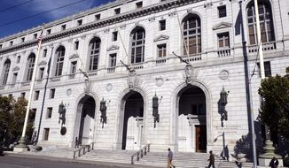 "FILE - In this Jan. 2, 2019, file photo, people walk past the Earl Warren Building that houses the California Supreme Court in San Francisco. Los Angeles County must pay a full $8 million damages award to the family of a Black man whose death evoked the more resent death of George Floyd in Minneapolis, the California Supreme Court ruled Monday, Aug. 10, 2020. While subduing Darren Burley in 2012, Los Angeles sheriff's deputies ""used their knees to pin him to the ground with as much body weight as possible,"" according to the court's unanimous ruling. (AP Photo/Eric Risberg, File)"