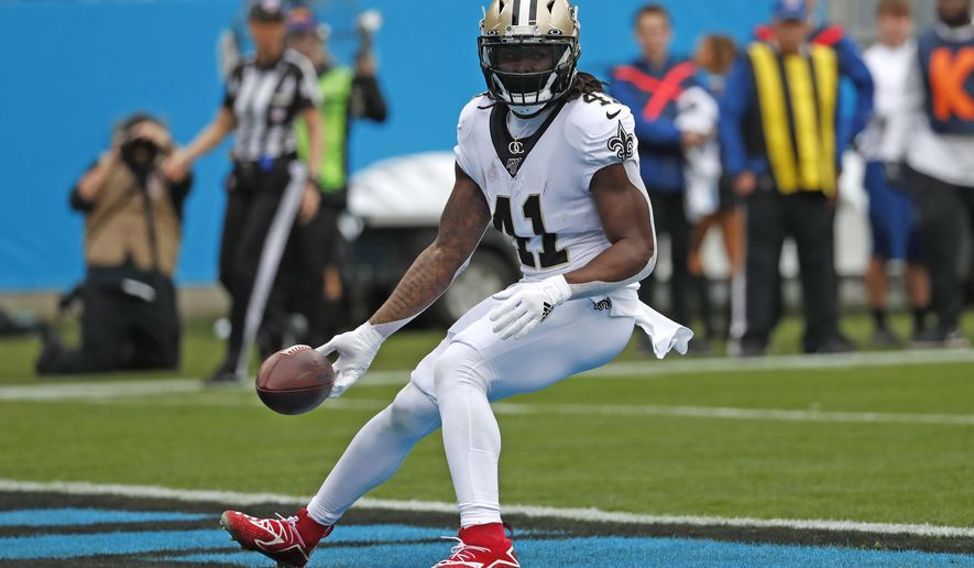 FILE - In this Dec. 29, 2019, file photo, New Orleans Saints running back Alvin Kamara scores a touchdown against the Carolina Panthers during the first half of an NFL football game in Charlotte, N.C. The versatile Kamara, who is entering his fourth pro season out of Tennessee, gained 1,330 yards from scrimmage last season with five touchdowns rushing and one receiving. (AP Photo/Gerry Broome, File)