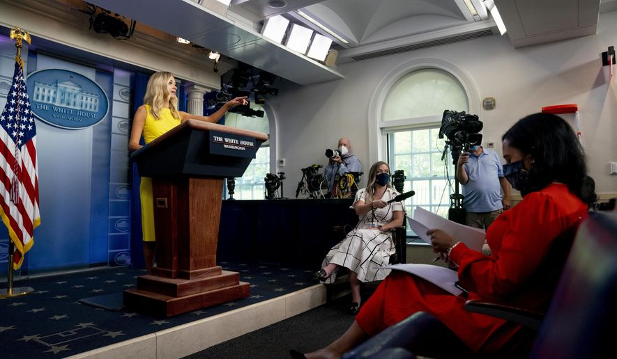 White House press secretary Kayleigh McEnany calls on a reporter during a press briefing in the James Brady Press Briefing Room at the White House, Monday, Aug. 10, 2020, in Washington. (AP Photo/Andrew Harnik)