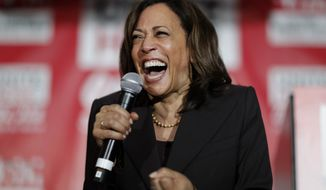 In this Nov. 8, 2019, file photo, then-Democratic presidential candidate Sen. Kamala Harris, D-Calif., reacts as she speaks at a town hall event at the Culinary Workers Union in Las Vegas. Democratic presidential candidate former Vice President Joe Biden has chosen  Harris as his running mate. (AP Photo/John Locher, File)