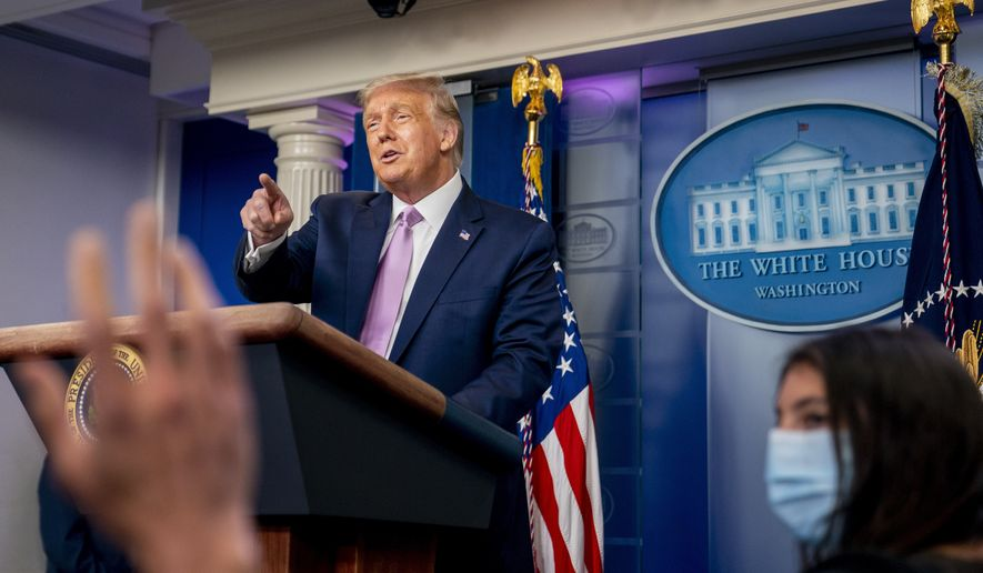 President Donald Trump calls on a reporter as he speaks at a news conference in the James Brady Press Briefing Room at the White House, Tuesday, Aug. 11, 2020, in Washington. (AP Photo/Andrew Harnik)