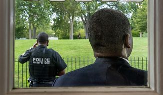 Members of the U.S. Secret Service stand guard outside the James Brady Press Briefing Room as President Donald Trump holds a news conference at the White House, Monday, Aug. 10, 2020, in Washington. Trump briefly left because of a security incident outside the fence of the White House. (AP Photo/Andrew Harnik)