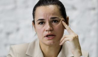 "Sviatlana Tsikhanouskaya, candidate for the presidential elections, speaks at a news conference after the Belarusian presidential election in Minsk, Belarus, Monday, Aug. 10, 2020.The country's central election commission said that with all ballots counted, Lukashenko, who has led Belarus for 26 years, took 80.23% of the vote and his main opposition challenger, Sviatlana Tsikhanouskaya, had only 9.9%. ""We don't recognize these results,"" Tsikhanouskaya, a former English teacher and political novice, told reporters Monday. (AP Photo/Sergei Grits)"