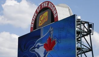 In this July 24, 2020, file photo, signage at Sahlen Field, home of the Toronto Blue Jays' Triple-A affiliate, in Buffalo, N.Y., is viewed. The Blue Jays will walk onto the field Tuesday, Aug. 11, 2020, as the host team for the first time in 2020. (AP Photo/Jeffrey T. Barnes, File) **FILE**