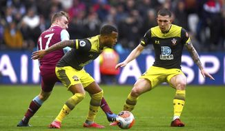 West Ham United's Jarrod Bowen, left, battles for the ball against Southampton's Ryan Bertrand, center, and Pierre-Emile Hojbjerg during their English Premier League soccer match at London Stadium, in London, Saturday, Feb. 29, 2020. (Victoria Jones/PA via AP)