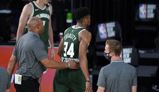 Milwaukee Bucks' Giannis Antetokounmpo (34) heads to the locker room after being ejected during the first half of an NBA basketball game against the Washington Wizards, Tuesday, Aug. 11, 2020, in Lake Buena Vista, Fla. (AP Photo/Ashley Landis, Pool) ** FILE **