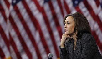 In this Oct. 2, 2019, photo, then-Democratic presidential candidate Sen. Kamala Harris, D-Calif., listens during a gun safety forum in Las Vegas. Democratic presidential candidate former Vice President Joe Biden has chosen  Harris as his running mate. (AP Photo/John Locher) **FILE**