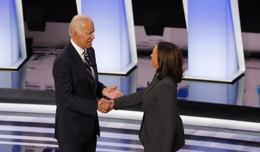 In this July 31, 2019, file photo, former Vice President Joe Biden shakes hands with Sen. Kamala Harris, D-Calif., before the second of two Democratic presidential primary debates at the Fox Theatre in Detroit. Democratic presidential candidate former Vice President Joe Biden has chosen  Harris as his running mate. (AP Photo/Paul Sancya, File)