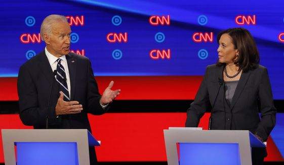 In this July 31, 2019, file photo, then-Democratic presidential candidate Sen. Kamala Harris, D-Calif., listens as Democratic presidential candidate former Vice President Joe Biden speaks during a Democratic presidential primary debate at the Fox Theatre in Detroit. Democratic presidential candidate former Vice President Joe Biden has chosen Harris as his running mate. (AP Photo/Paul Sancya, File)  **FILE**